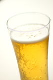 Close up of beer glass with bubbles Stock Photo