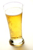 Close up of beer glass with bubbles Royalty Free Stock Image