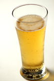 Close up of beer glass with bubbles Royalty Free Stock Images