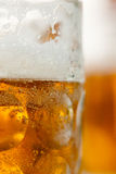 Close up of beer mug vertial with mug in background Royalty Free Stock Photos