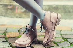 Close up of beige boots on child's feet Royalty Free Stock Photography