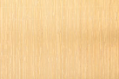 Close up beige brown bamboo mat striped background texture pattern Stock Photography