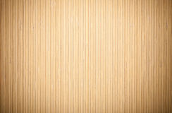 Close up beige brown bamboo mat striped background texture pattern Royalty Free Stock Photo