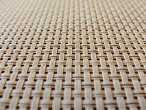 Close-up of beige fabric plastic lattice, grid texture; pattern of horizontal and vertical interwoven lines may be used as a backg royalty free stock photo