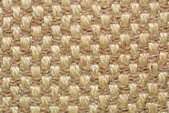 A close up of beige fabric texture; background image. stock photography