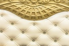 Close-up Beige fabric upholstered headboard with buttons textile background, retro Stylish bedroom furniture with royalty free stock image