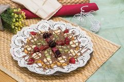 Close up of Belgian waffle with mixed fruit, chocolate chips and strawberry sauce. Close up of a Belgian waffle with mixed fruit, chocolate chips and strawberry Royalty Free Stock Photos