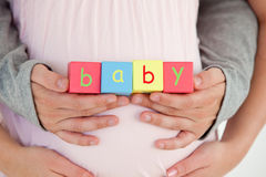 Close-up of the belly of a pregnant woman Royalty Free Stock Image