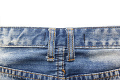 Close up belt loops on blue jeans isolated on white background Stock Image
