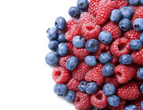 Close-up of berries over white background. Blueberries and raspberries over white background with copy space Royalty Free Stock Photos