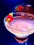 Close up of berry alcohol drink with cherry decoration. Stock Photo
