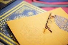 Old spectacles on bespoke book covers. Close up of bespoke book covers and old spectacles at a book binder stock image