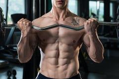 Close Up Biceps Workout Of A Man Stock Photos