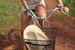 Close-up of bicycle basket with a hat Stock Image
