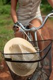 Close-up of bicycle basket with a hat Stock Photography