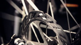 Close up of Bicycle disc Brake and Wheel spokes stock video