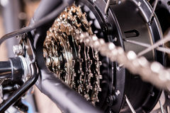 Close up of  bicycle gear and black electric motor. Close up of  a glossy  bicycle gear and black electric motor Royalty Free Stock Photos