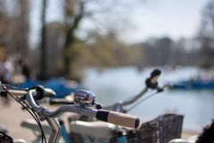 Close-up - bicycle handlebars with bell. And a sunny background Royalty Free Stock Photos