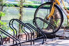 Close up of bicycle loacked with parking rack in city Royalty Free Stock Photos