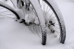 Bicycle tires covered in snow stock images