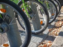 Close up on bicycle wheels as a transportation option in the city royalty free stock photography