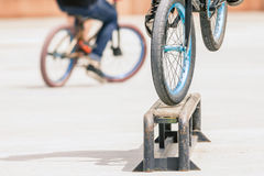 Close-up of bicycle wheels doing trick by rail Royalty Free Stock Photography