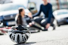 Close-up of a bicycling helmet fallen down on the ground after a. Ccidental collision between bicycle and a 4x4 car stock photos