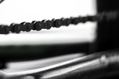 Close up of a bicylce chain in black and white stock image