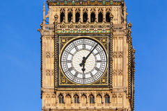 Close up of Big Ben`s Clock Face with a clear blue sky behind Stock Images