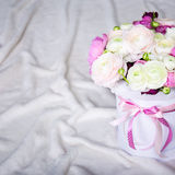 Close up of big bouquet of summer flowers in round box over whit Royalty Free Stock Photo