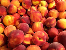 Close up of a big box of peaches at the super market Royalty Free Stock Image
