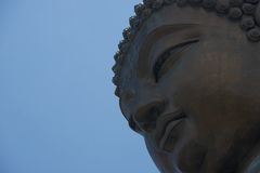 Close-up of Big Buddha face from below Stock Photography