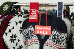 Close up on a big Christmas sale sign for winter clothes. Stock Photo