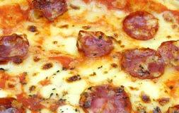 Close up of big fat italian salami pizza Stock Photo