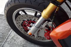 close up of big motorcycle front wheel, focus disc brake royalty free stock photography