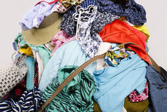 Close up on a big pile of clothes and accessories thrown on the floor. Stock Photo