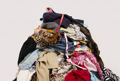 Close up on a big pile of clothes and accessories thrown on the floor. Royalty Free Stock Photography