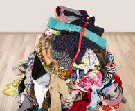 Close up on a big pile of clothes and accessories thrown on the floor. Stock Photos
