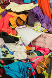 Close up on a big pile of clothes and accessories thrown on the ground. Stock Images