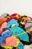 Close up on a big pile of clothes and accessories thrown on the ground. Royalty Free Stock Photo