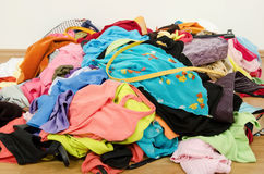 Close up on a big pile of clothes and accessories thrown on the ground. Royalty Free Stock Image