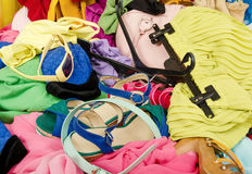 Close up on a big pile of clothes and accessories thrown on the ground. Royalty Free Stock Photography