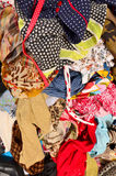 Close up on a big pile of clothes and accessories thrown on the ground. Stock Image