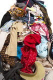 Close up on a big pile of clothes and accessories thrown on the ground. Royalty Free Stock Photos