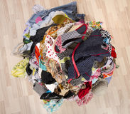 Close up on a big pile of clothes and accessories thrown on the ground. Stock Photo