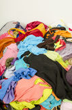 Close up on a big pile of clothes and accessories thrown on the Stock Images