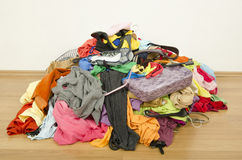 Close up on a big pile of clothes and accessories thrown on the Royalty Free Stock Photos