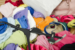 Close up on a big pile of clothes and accessories thrown on the Stock Image