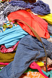 Close up on a big pile of clothes and accessories thrown on the Royalty Free Stock Photo