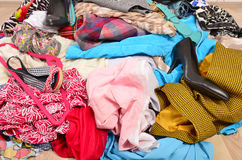 Close up on a big pile of clothes and accessories thrown on the Royalty Free Stock Photography